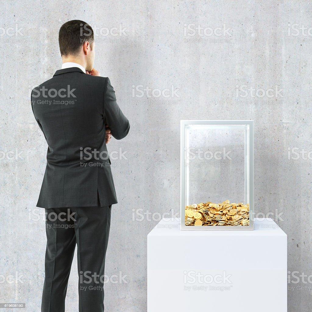 Businessman looking at donation box stock photo