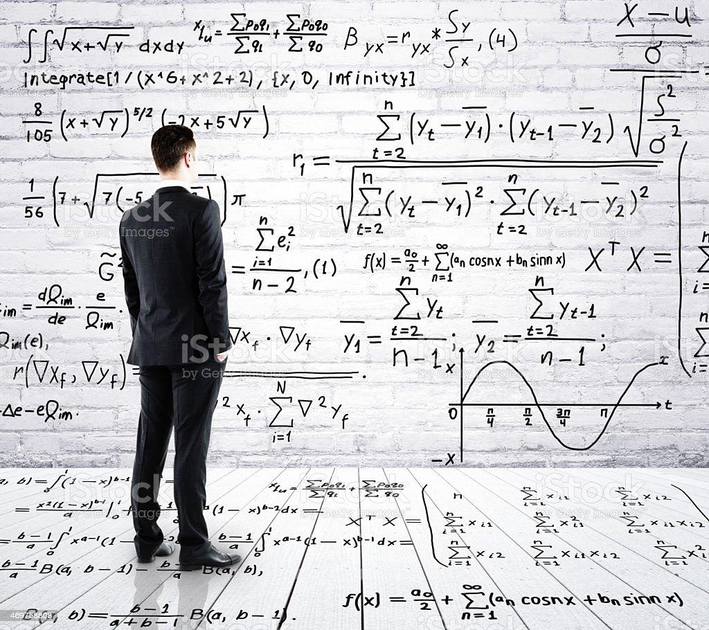 businessman looking at formula stock photo