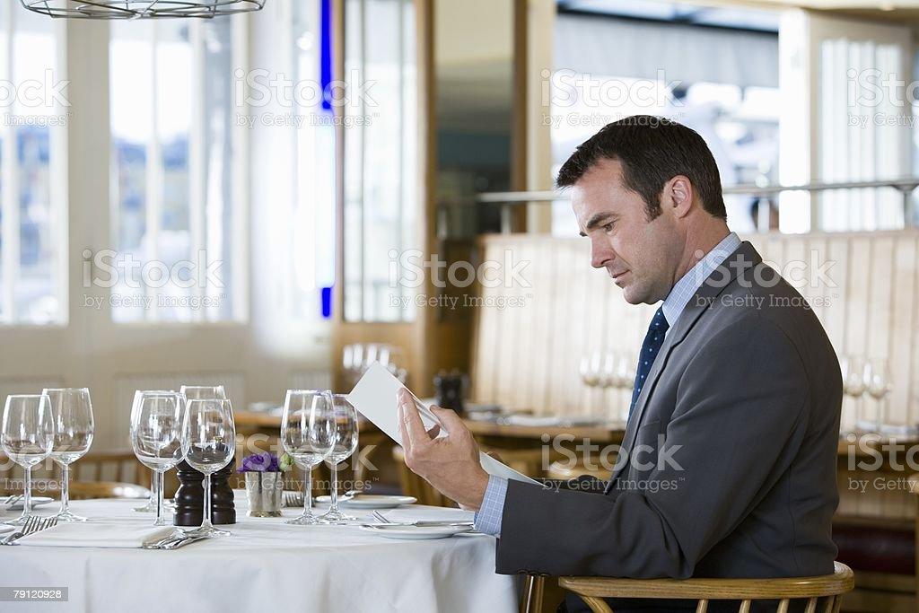 Businessman looking at menu royalty-free stock photo