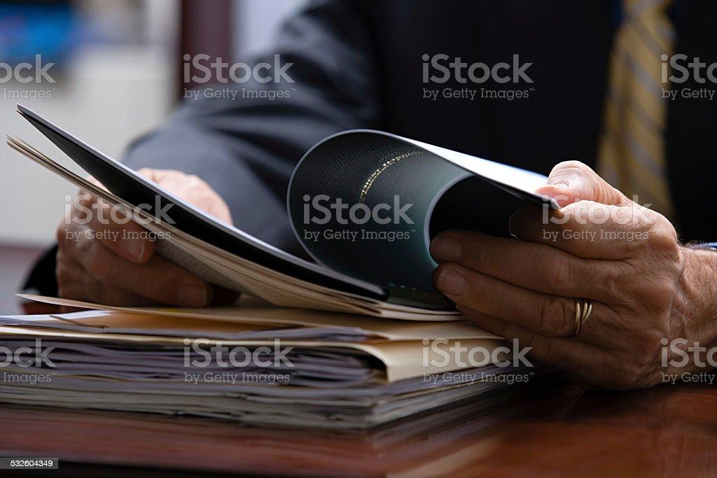 Businessman looking at paperwork stock photo