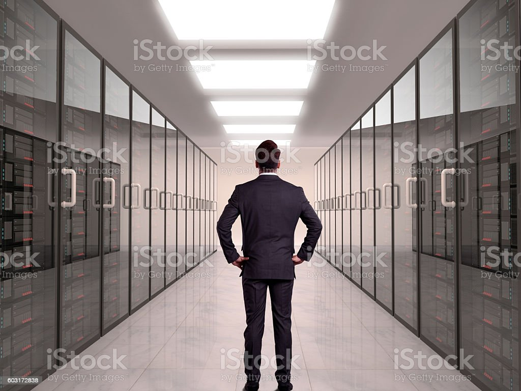 Businessman looking at server stock photo