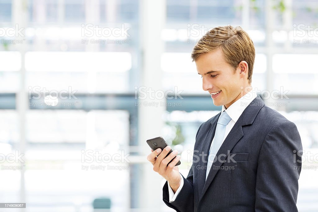 Businessman Looking At Smartphone royalty-free stock photo
