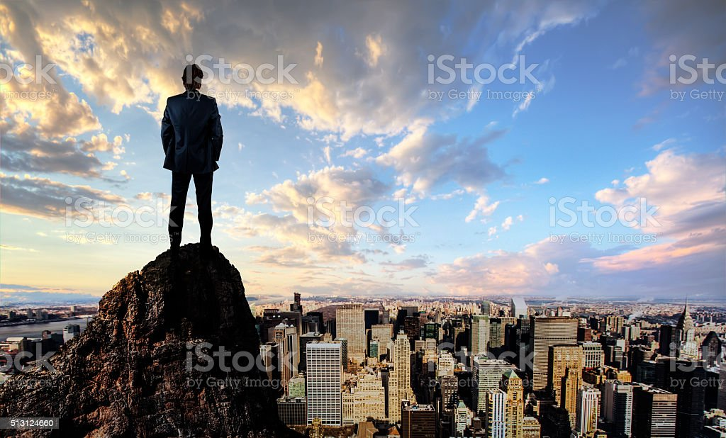 Businessman looking at the city stock photo