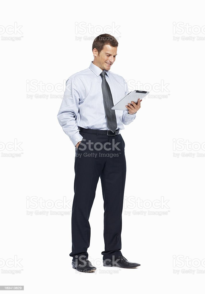 Businessman looking at the internet on an electronic pad royalty-free stock photo