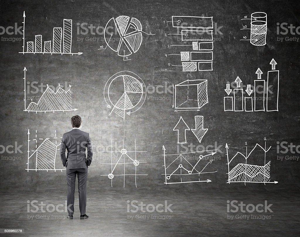 Businessman looking at trade graphs stock photo