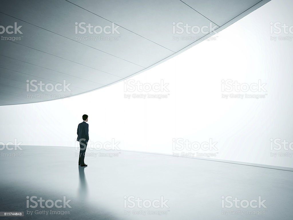 Businessman looking at wide shining screen stock photo