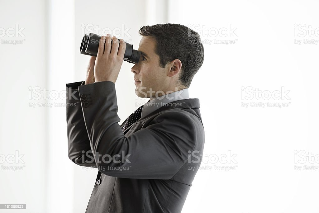 Businessman looking back on the past royalty-free stock photo