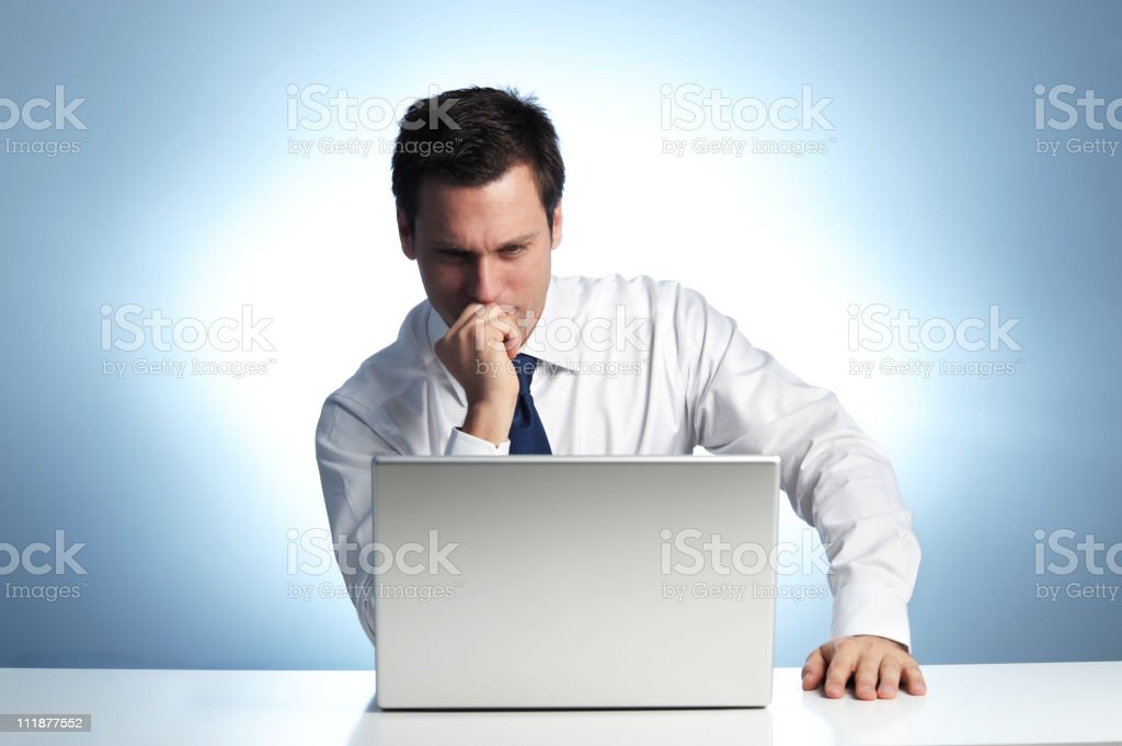 IT Businessman Looking Confused at Laptop Computer royalty-free stock photo