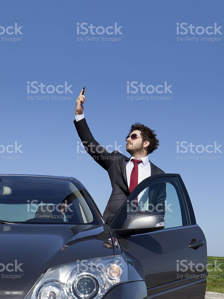 Businessman Looking For Signal royalty-free stock photo
