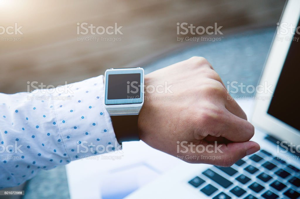 Businessman looking  his smart Watch stock photo