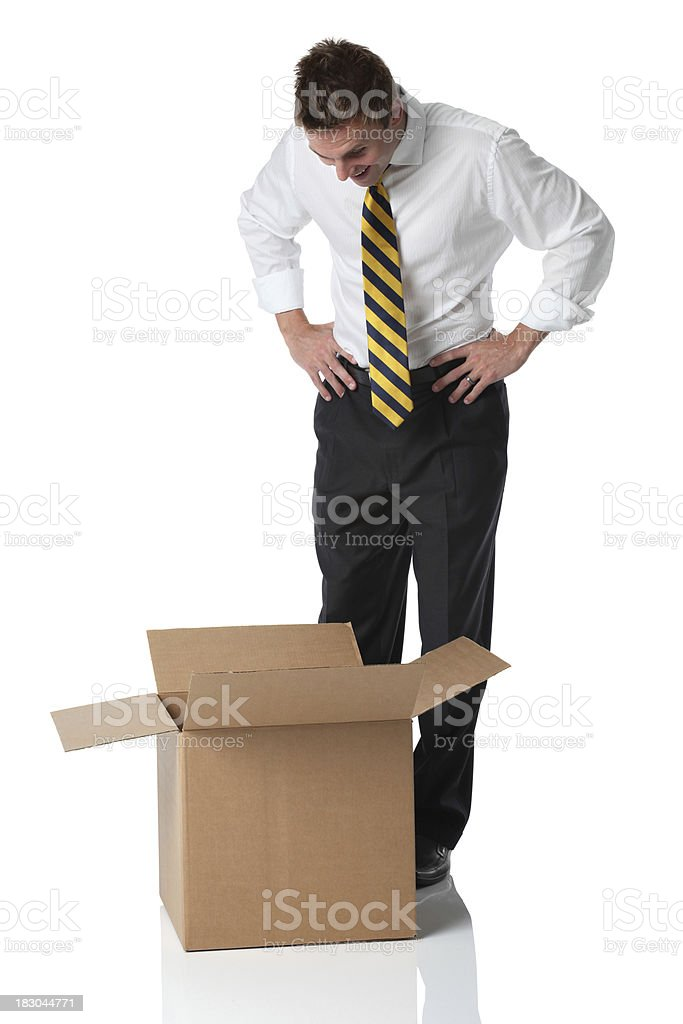Businessman looking into a cardboard box royalty-free stock photo