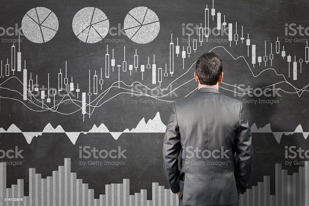Businessman looking into stock market data stock photo