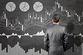 Businessman looking into stock market data