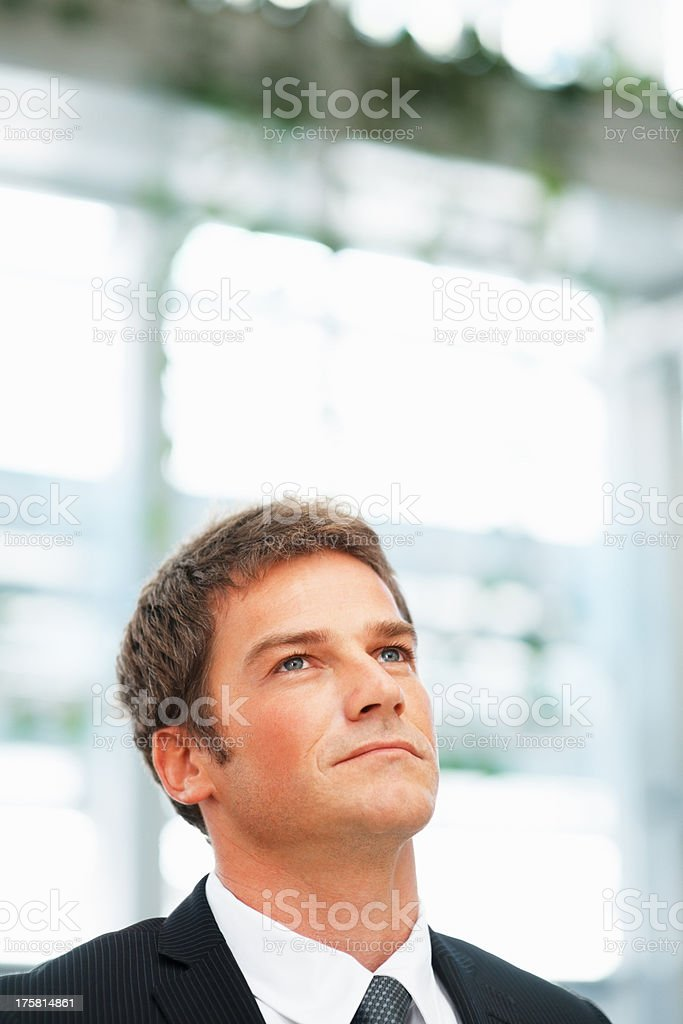 Businessman looking off into distance stock photo