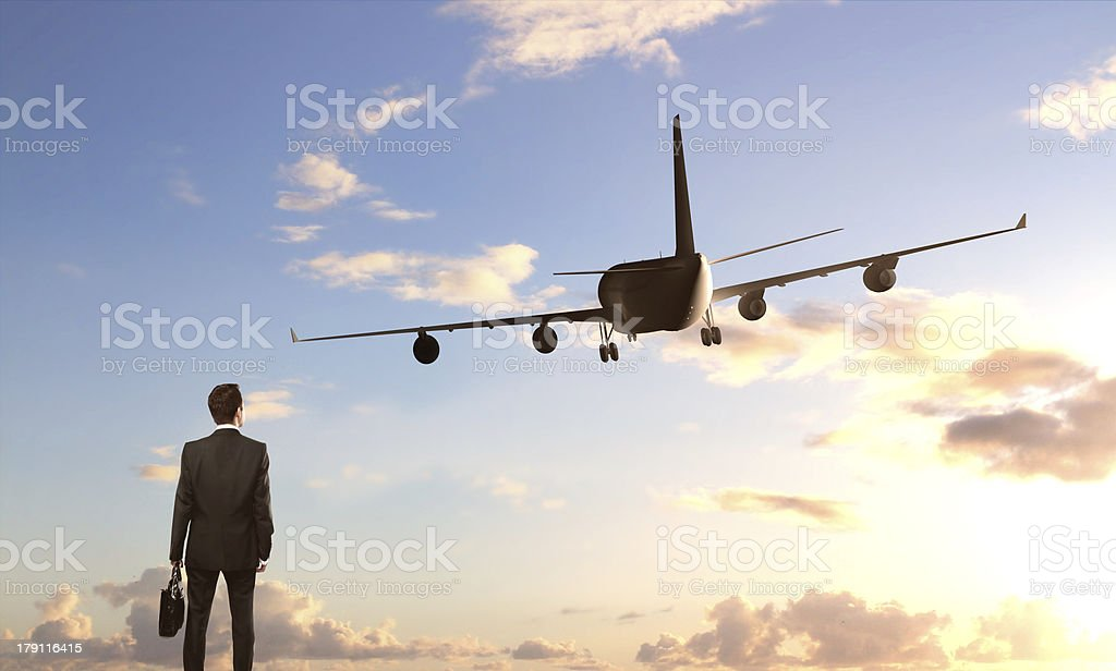 businessman looking on  airplane royalty-free stock photo
