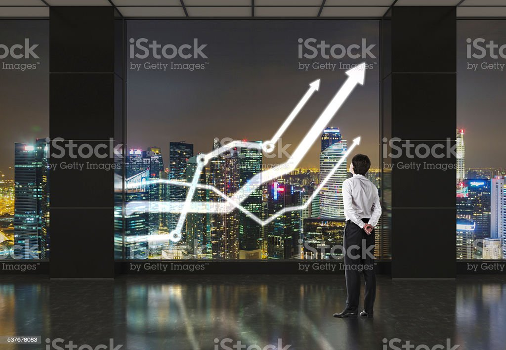 businessman looking on chart stock photo