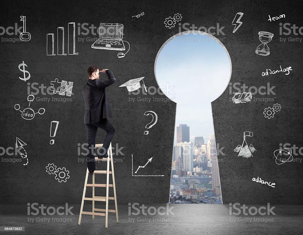 businessman looking on keyhole stock photo