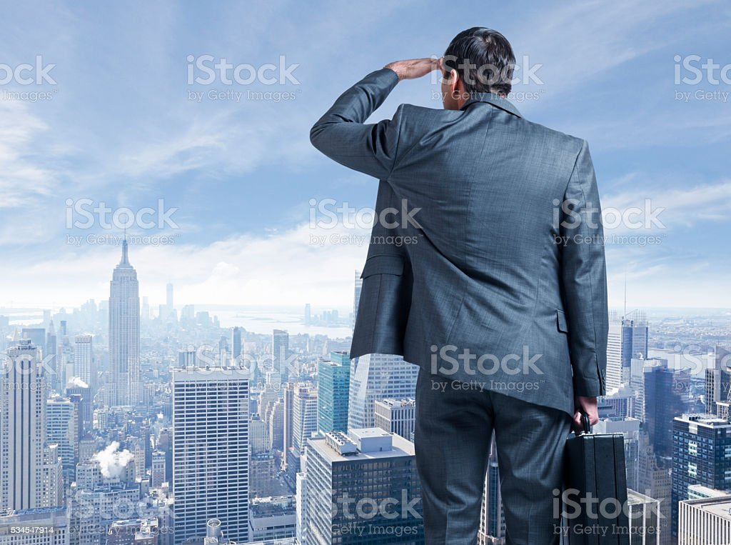 Businessman Looking Out Over The New York City Skyline stock photo