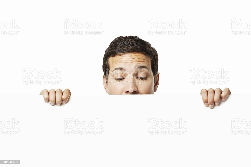 Businessman Looking Over a Wall - Isolated royalty-free stock photo
