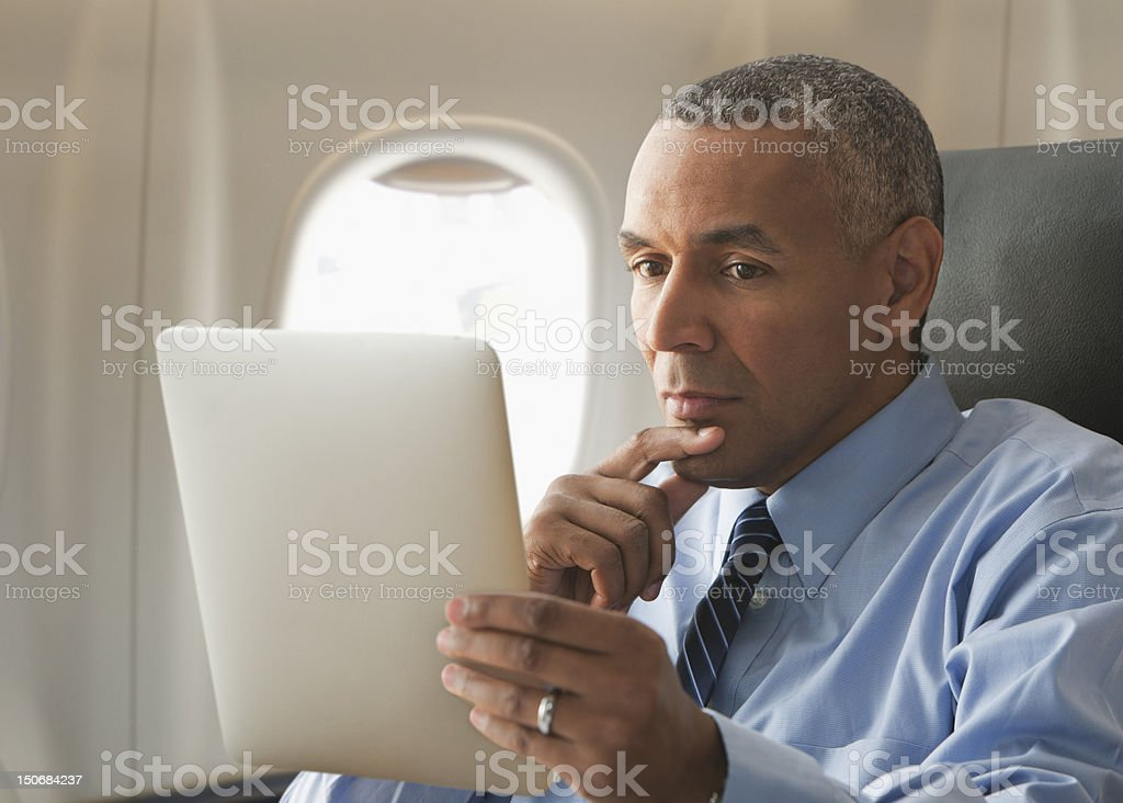 Businessman looking over electronic tablet royalty-free stock photo