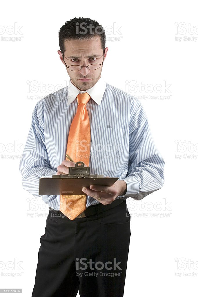 Businessman looking over his glasses with clipboard on hand royalty-free stock photo