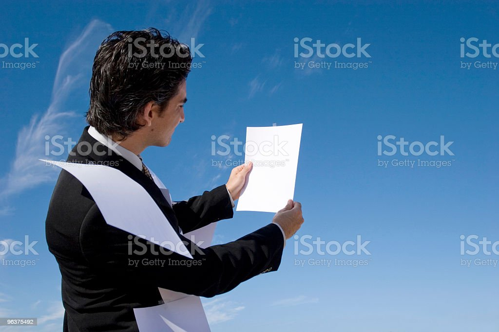 Businessman looking over paperwork royalty-free stock photo