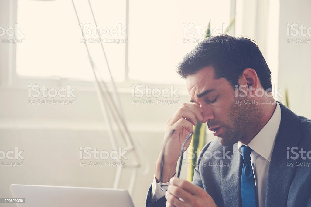 Businessman looking stressed. stock photo
