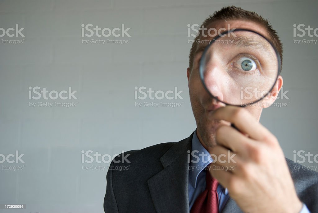 Businessman Looking Surprised with Magnifying Glass royalty-free stock photo