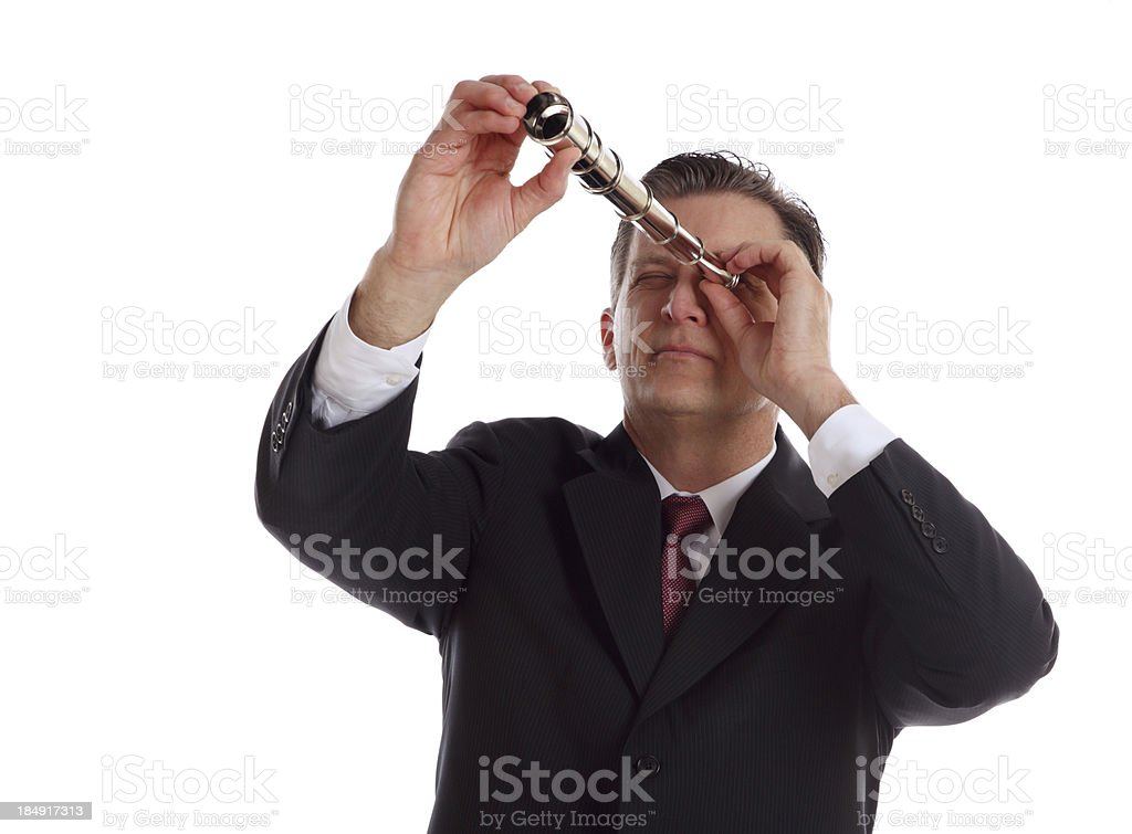 Businessman Looking Through a Periscope stock photo