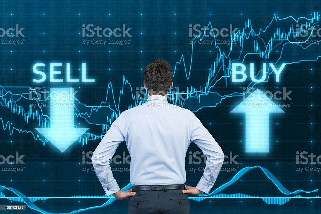 businessman looking to graph stock photo