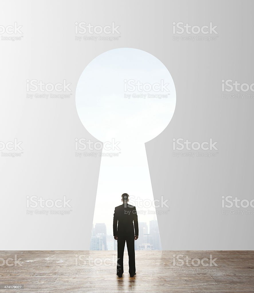 businessman looking to keyhole stock photo
