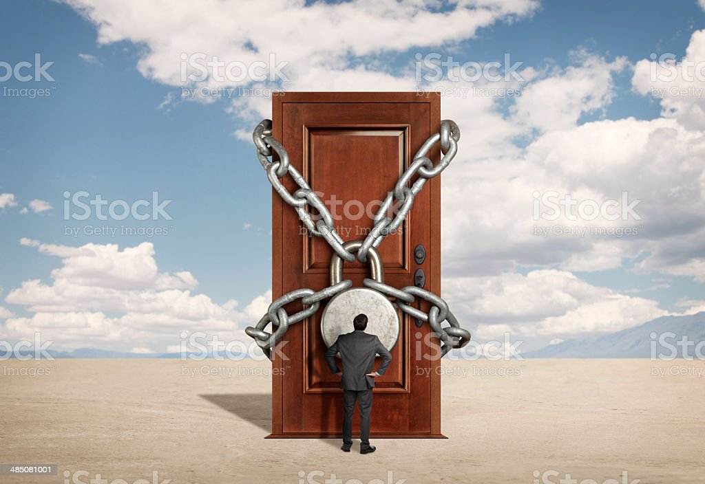 Businessman looking up at a padlocked door in desert scene royalty-free stock photo & Businessman Looking Up At A Padlocked Door In Desert Scene stock ... Pezcame.Com