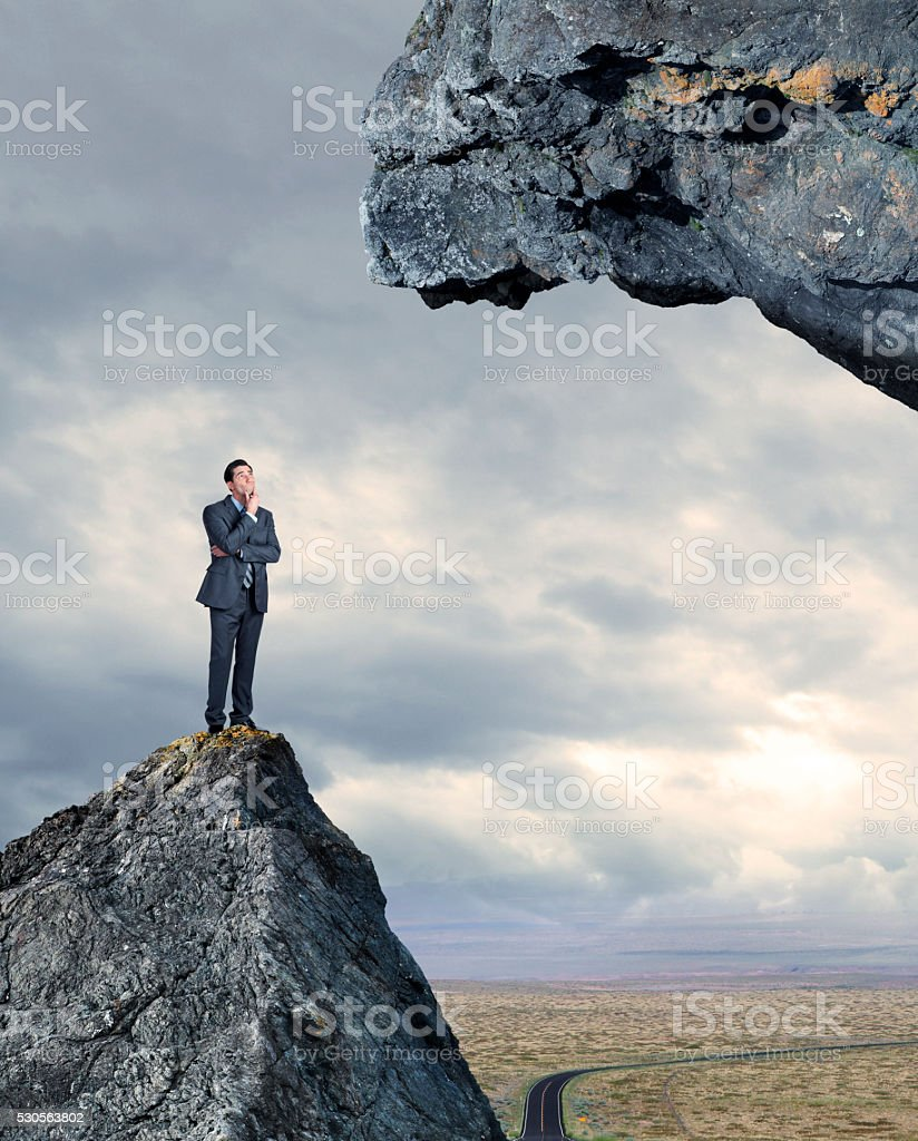 Businessman Looking Up At Next Level He'll Need To Scale stock photo