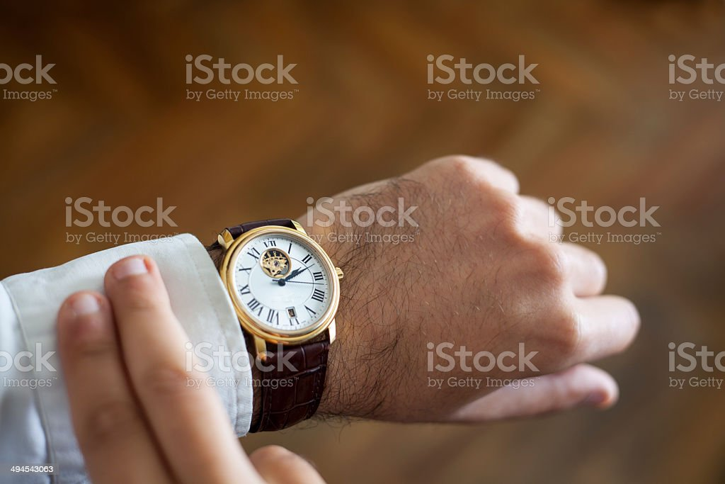 Businessman Looks at His Watch stock photo