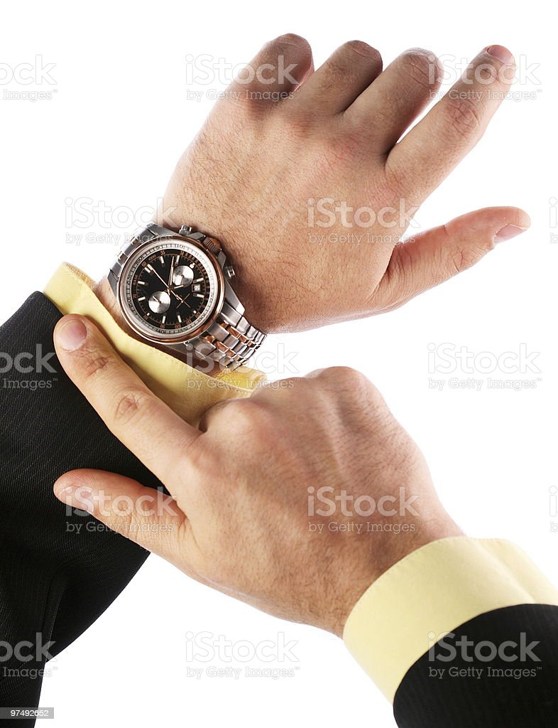 Businessman looks at his watch royalty-free stock photo