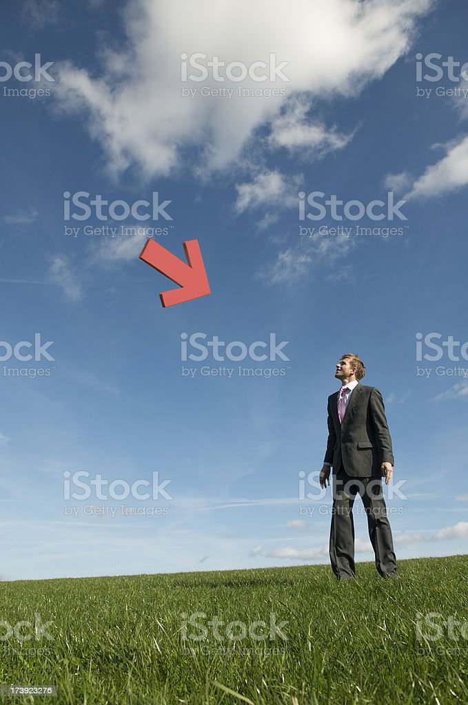 Businessman Looks Up at Red Arrow in Sky royalty-free stock photo