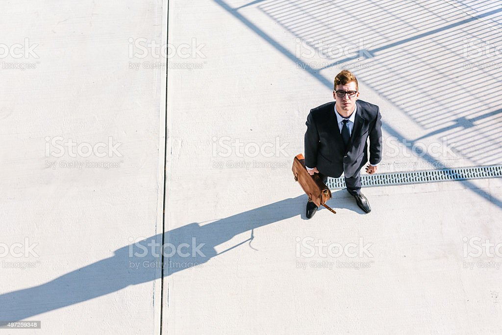 Businessman looks up stock photo