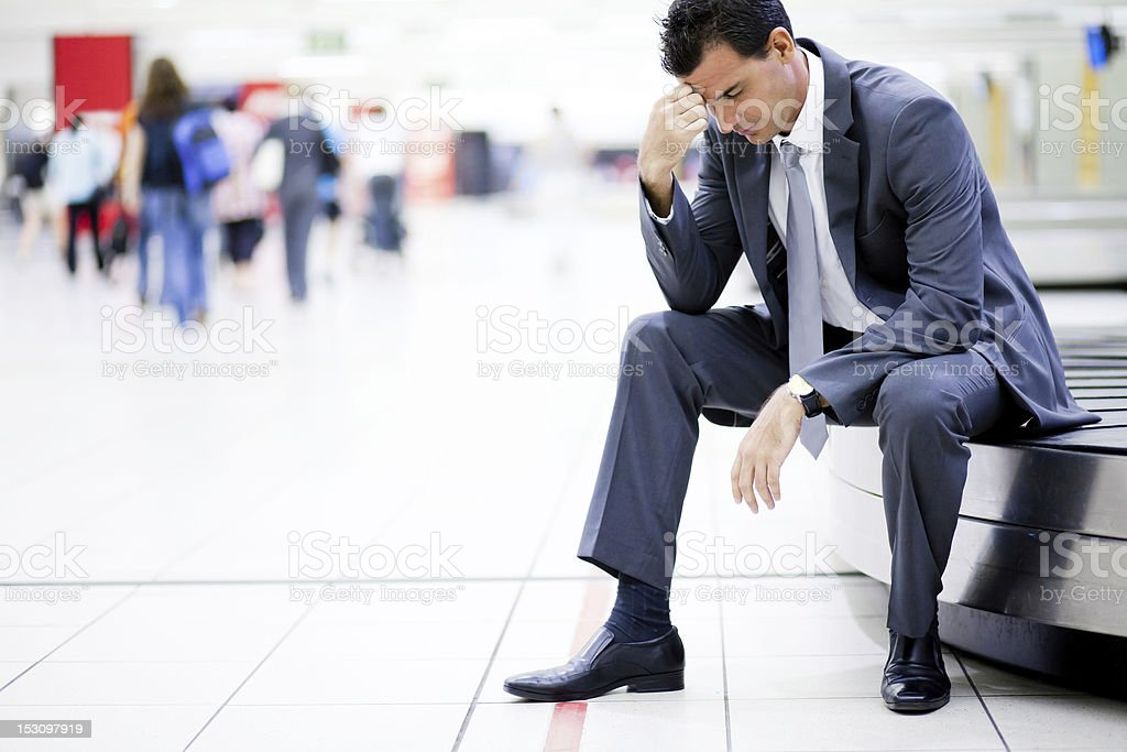 businessman lost his luggage at airport stock photo