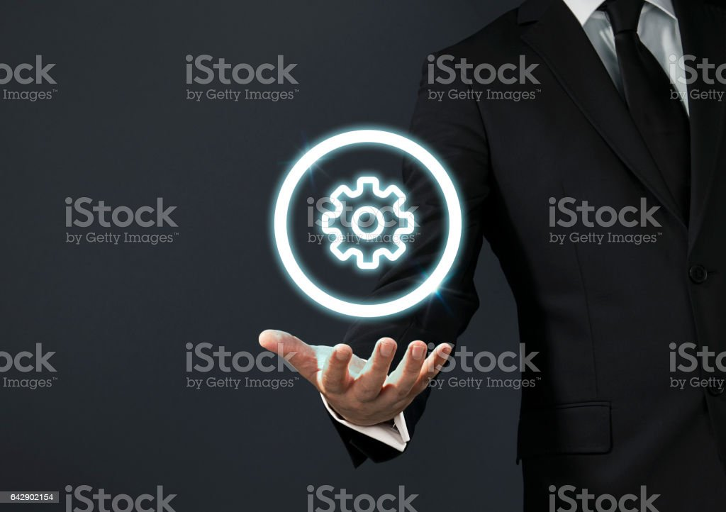 Businessman magical touch concept - settings stock photo