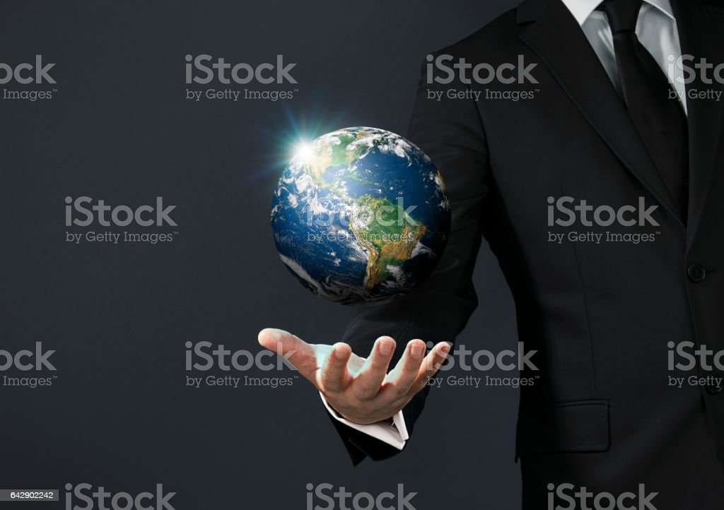 Businessman magical touch concept -  world stock photo