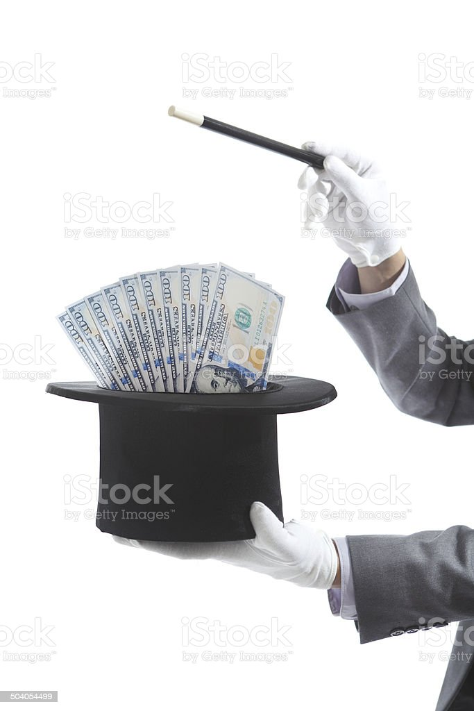 Businessman Magician Making Money with Magic Tricks on White Background stock photo
