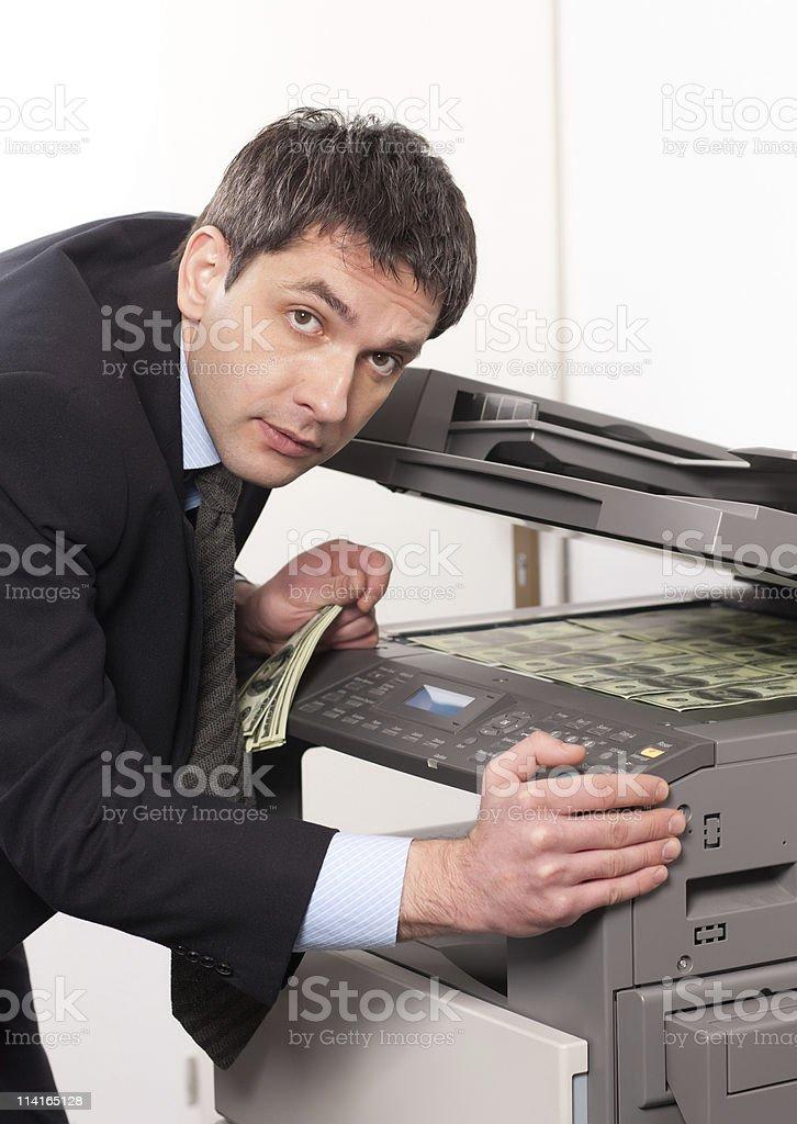 Businessman make false money on copy machine stock photo
