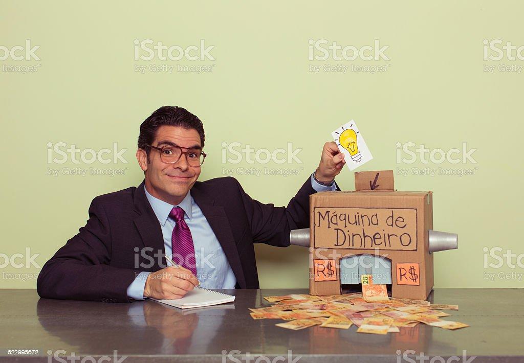 Businessman Makes Money with Homemade Money Machine stock photo