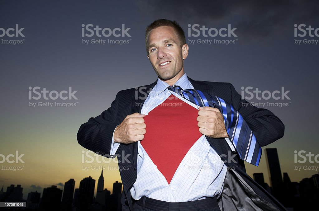 Businessman Makes Superhero Change Over Skyline royalty-free stock photo