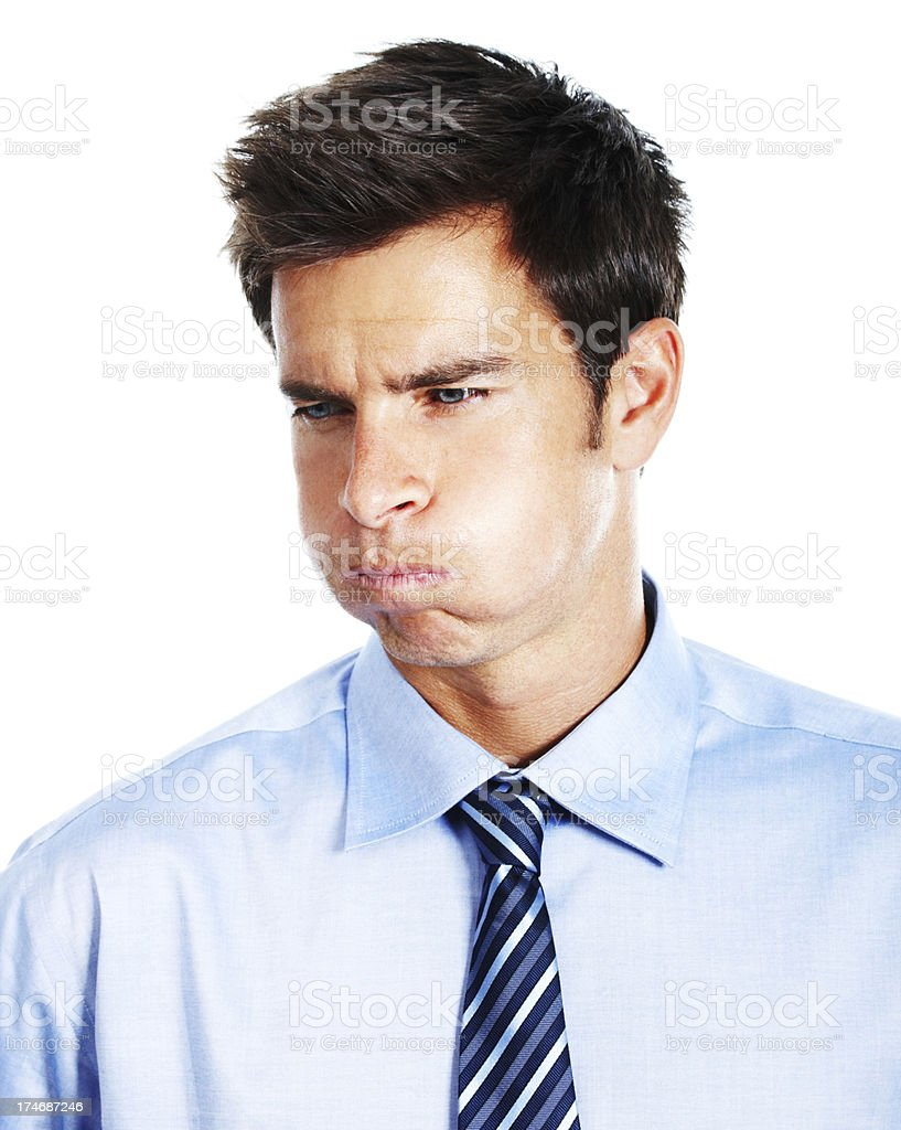 Businessman making a face against white background stock photo