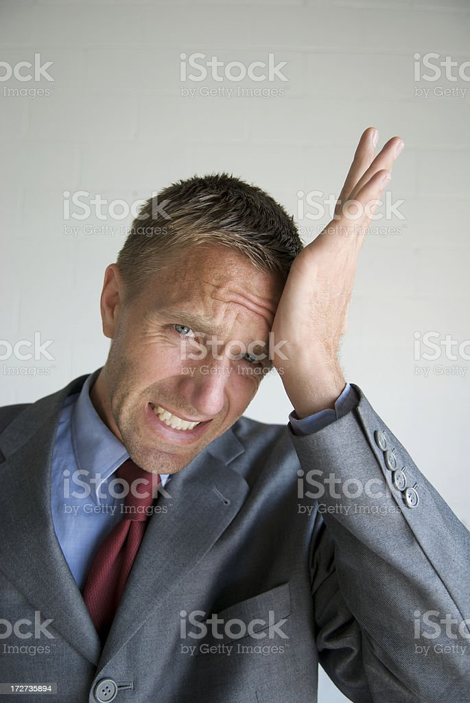 Businessman Making Mistake Slapping Forehead royalty-free stock photo