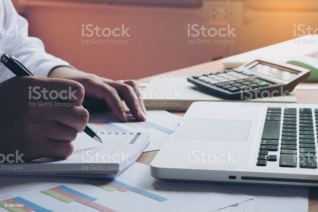 Businessman making notes on the paper in his office stock photo