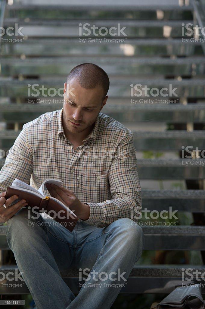 Businessman making notes stock photo