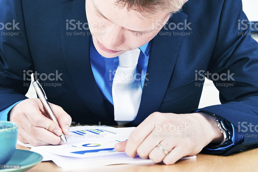 Businessman making notes to report stock photo