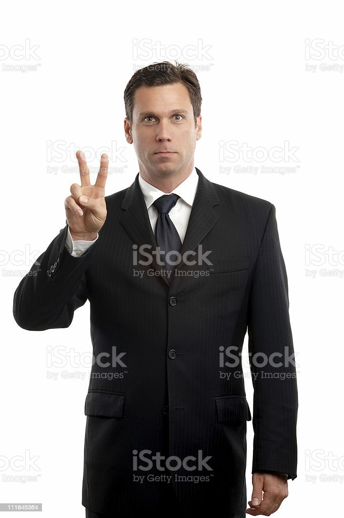 Businessman Making Peace Sign royalty-free stock photo
